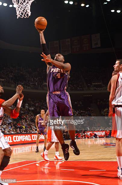 Alton Ford of the Phoenix Suns gets an easy layup against the Houston Rockets during first quarter NBA action at the Compaq Center in Houston Texas...
