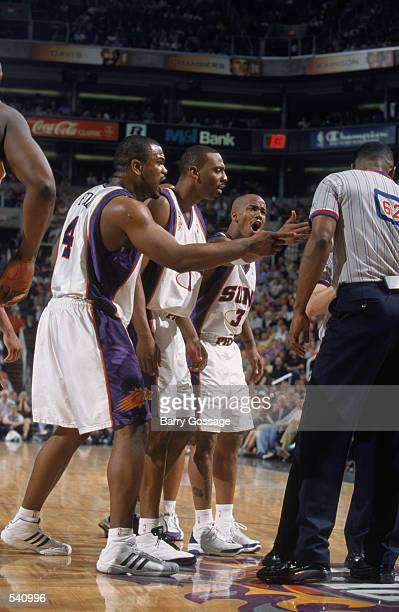 Alton Ford#4 of the Phoenix Suns argues with the referee Michael Henderson with teammates Anfernee Hardaway and Stephon Marbury during the game...