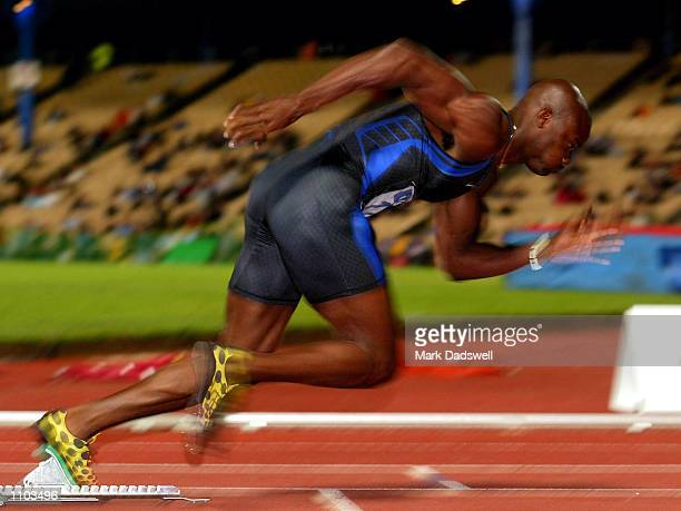 Alvin Harrison of the USA bursts out of the blocks on the mens 400 metres during the Telstra ASeries IAAF Athletics Grand Prix meeting held at...