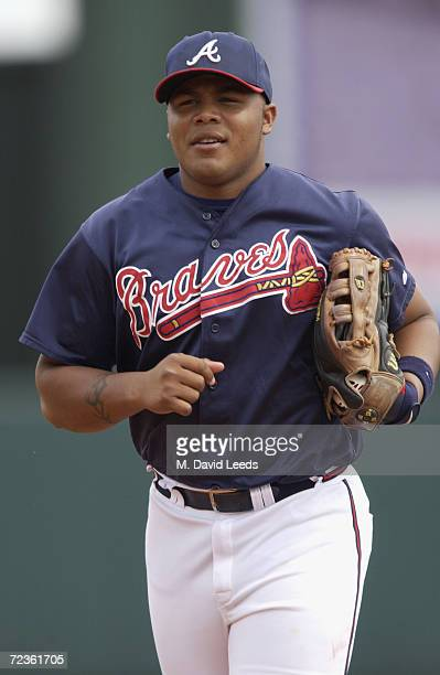 Andruw Jones of the Atlanta Bravesruns in after an inning during the spring training game against the Tampa Bay Devil Rays at Disney's Wide World of...