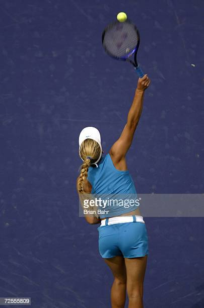 Anna Kournikova of Russia hits a serve in her 61 64 loss to Lilia Osterloh of the USA during the Pacific Life Open at the Indian Wells Tennis Garden...