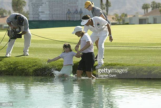 Annika Sorenstam brings her caddie Terry McNamara and his daughter Reilly as her sister Charlotta Sorenstam looks on into the pond after winning the...