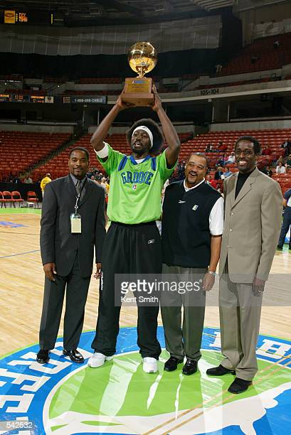 Ansu Sesay of the Greenville Groove accepts his MVP award and shows it to the crowd Also pictured are from left to right Aaron Jones Groove head...