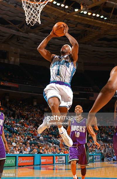 Baron Davis of the Charlotte Hornets goes to the basket against the Milwaukee Bucks during the game at the Charlotte Coliseum in Charlotte North...