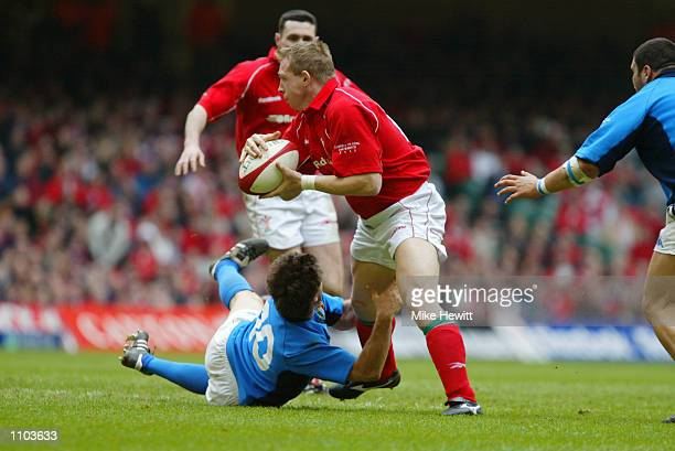 Barry Williams of Wales is tackled by Ramiro Pez of Italy during the Lloyds TSB Six Nations Championship match played at the Millennium Stadium in...
