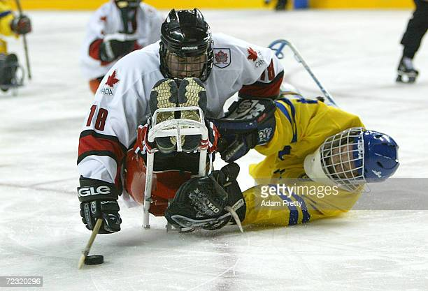 Billy Bridges of Canada scores past Kenth Jonsson of Sweden during the Canada and Sweden Bronze Medal Sledge Hockey match which Sweden won in sudden...