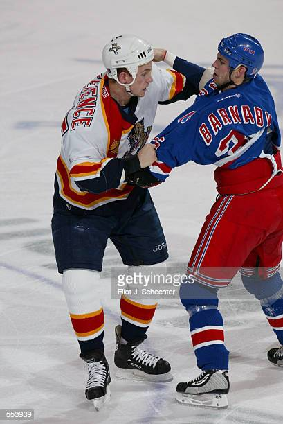 Brad Ference of the Florida Panthers and Matthew Barnaby of the New York Rangers exchange punches during the game at National Car Rental Center in...