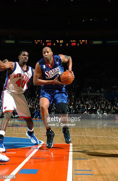 Center Derrick Coleman of the Philadelphia 76ers drives down the lane past forward Kurt Thomas of the New York Knicks during the NBA game at Madison...