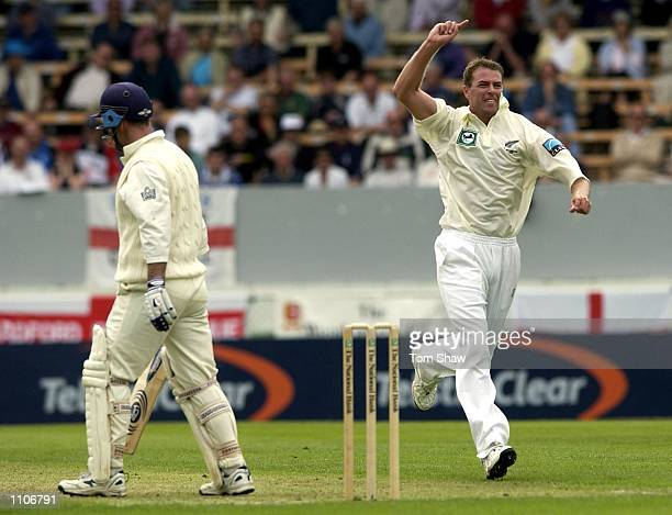 Chris Drum of New Zealand celebrates taking the wicket of Graham Thorpe of England during the 1st day of the New Zealand v England 1st Test at the...