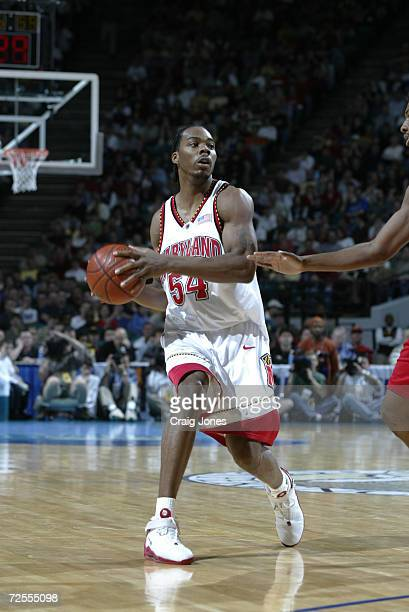 Chris Wilcox of Maryland moves against the defense of North Carolina State during the ACC Tournament game at the Charlotte Coliseum in Charlotte...
