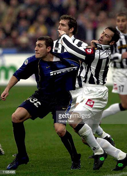 Christian Vieri of Inter Milan and Marc Juliano of Juventus tussle during the Serie A 26th Round League match between Inter Milan and Juventus played...