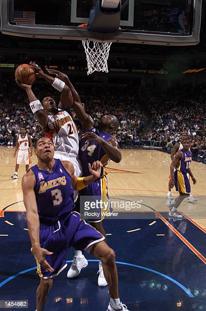 Danny Fortson of the Golden State Warriors shoots the ball over Shaquille O''Neal of the Los Angeles Lakers at The Arena in Oakland California...