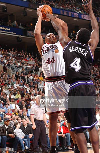 Derrick Coleman of the Philadelphia 76ers attempt a jumpshot over Chris Webber of the Sacramento Kings at the First Union Center in Philadelphia...