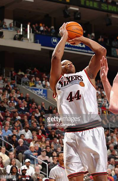 Derrick Coleman of the Philadelphia 76ers attempts a shot over the New Jersey Nets'' defense at the First Union Center in Philadelphia Pennsylvania...