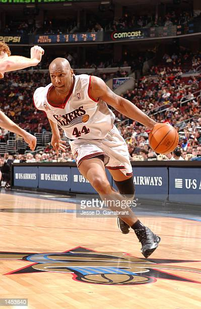 Derrick Coleman of the Philadelphia 76ers drives to the basket against the New Jersey Nets at the First Union Center in Philadelphia Pennsylvania...