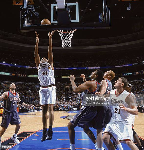 Derrick Coleman of the Philadelphia 76ers leaps for the basket during the game against the New Jersey Nets at the First Union Center in Philadelphia...