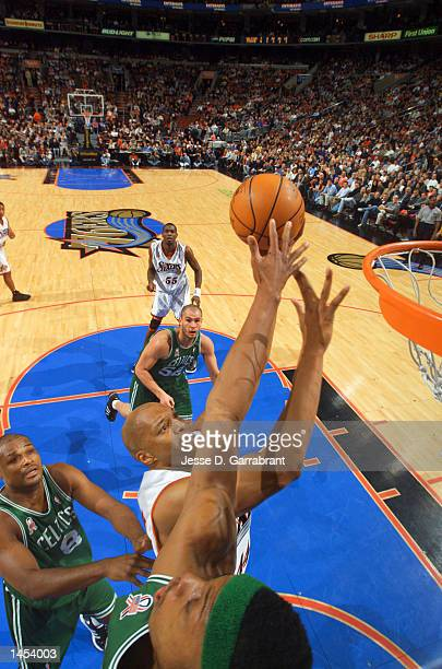 Derrick Coleman of the Philadelphia 76ers puts up a shot over Paul Pierce of the the Boston Celtics as Antoine Walker of the Boston Celtics watches...