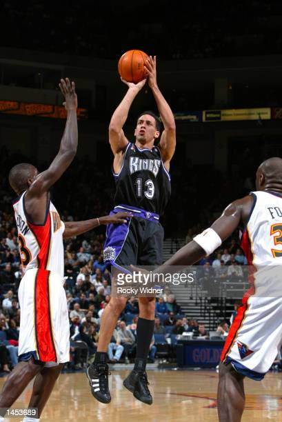 Doug Christie of the Sacramento Kings shoots the ball over Jason Richardson of the Golden State Warriors at The Arena in Oakland California DIGITAL...