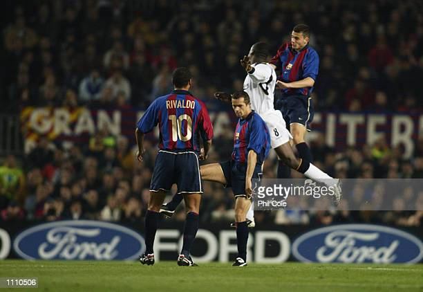 Emile Heskey of Liverpool is outnumbered in midfield as Rivaldo Phillip Cocu and Thiago Motta of Barcelona win the ball during the UEFA Champions...