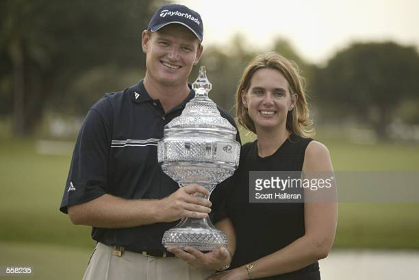 Ernie Els of South Africa poses with his wife Leizl and the trophy after winning the Genuity Championship at Doral Golf Resort and Spa in Miami...