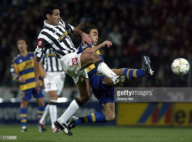 Fbaio Cannvaro of Parma and Nicola Amoruso of Juventus in action during the Serie A 28th Round League match played between Parma and Juventus at the...