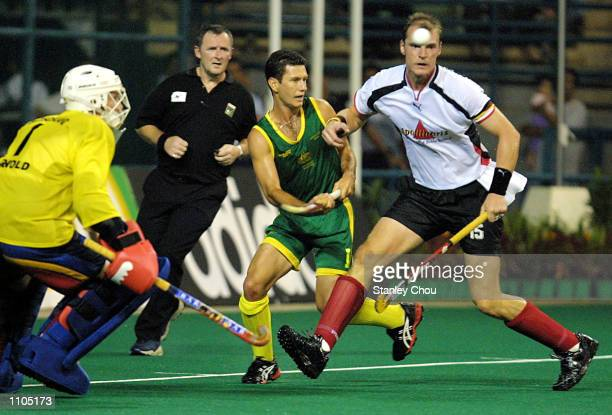 Florian Kunz of Germany is challenged by Jamie Dwyer of Australia during the World Cup Hockey final between Germany and Australia held at the Bukit...