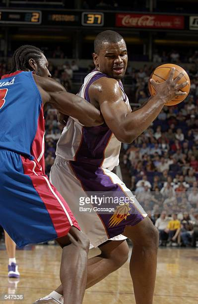 Forward Alton Ford of the Phoenix Suns posts up forward Ben Wallace of the Detroit Pistons during the NBA game at America West Arena in Phoenix...