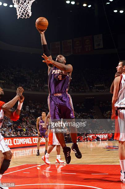 Forward Alton Ford of the Phoenix Suns shoots a layup during the NBA game against the Houston Rockets at Compaq Center in Houston Texas The Suns won...