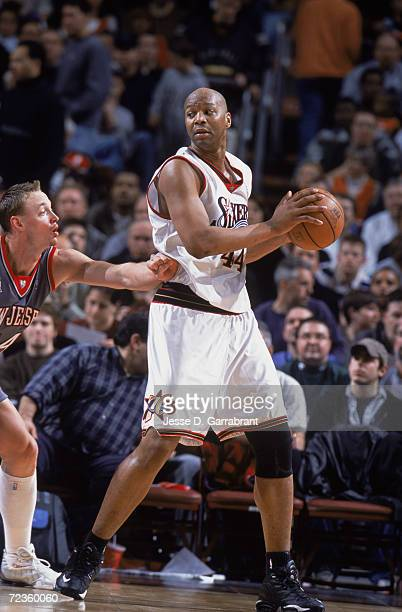 Forward Derrick Coleman of the Philadelphia 76ers posts up forward Keith Van Horn of the New Jersey Nets during the NBA game at the First Union...