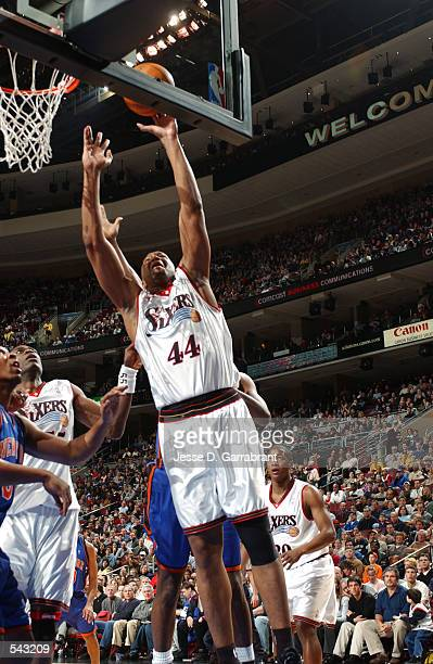 Forward Derrick Coleman of the Philadelphia 76ers shoots a layup during the NBA game against the New York Knicks at First Union Center in...