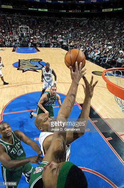 Forward Derrick Coleman of the Philadelphia 76ers shoots over forward Paul Pierce of the Boston Celtics during the NBA game at the First Union Arena...