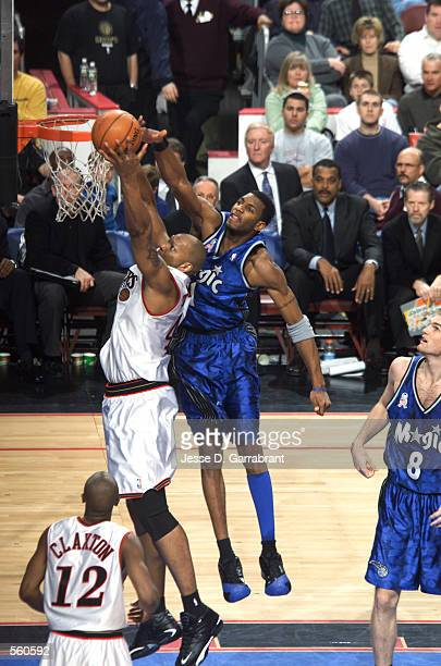 Forward Derrick Coleman of the Philadelphia 76ers shoots over forward Tracy McGrady of the Orlando Magic during the NBA game at the First Union Arena...