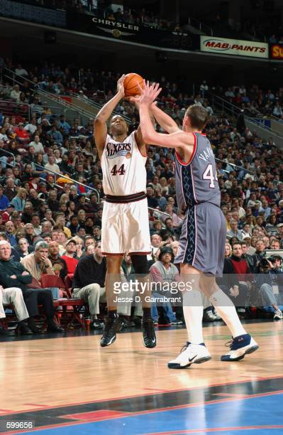 Forward Derrick Coleman of the Philadelphia 76ers shoots the ball over forward Keith Van Horn of the New Jersey Nets during the NBA game at the First...