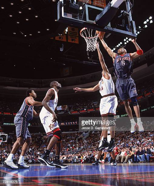 Forward Kenyon Martin of the New Jersey Nets rebounds over forward Derrick Coleman of the Philadelphia 76ers during the NBA game at the First Union...