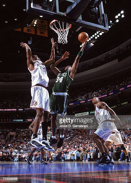 Forward Paul Pierce of the Boston Celtics shoots the ball as forward Derrick McKey of the Philadelphia 76ers blocks during the NBA game at the First...