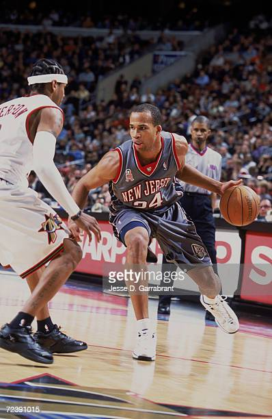 Forward Richard Jefferson of the New Jersey Nets drives past guard Allen Iverson of the Philadelphia 76ers during the NBA game at the First Union...