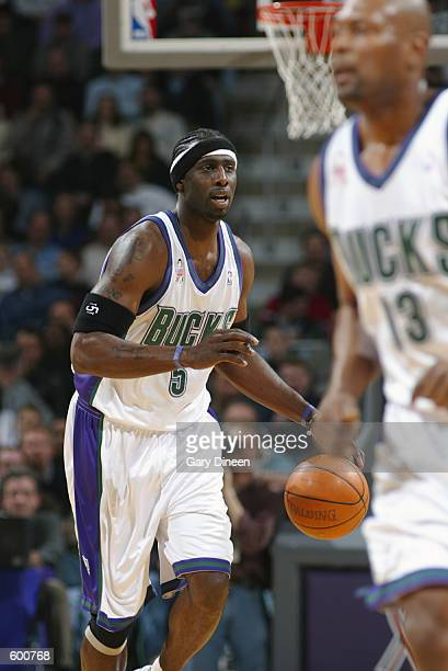 Forward Tim Thomas of the Milwaukee Bucks dribbles the ball during the NBA game against the Dallas Mavericks at the Bradley Center in Milwaukee...