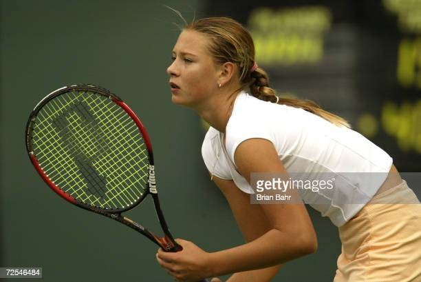 Fourteenyearold Maria Sharapova of Russia readies herself for a serve from Monica Seles of the USA during the Pacific Life Open at the Indian Wells...
