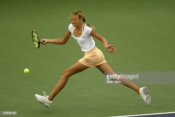 Fourteenyearold Maria Sharapova of Russia stretches out to make a return against Monica Seles of the USA during the Pacific Life Open at the Indian...