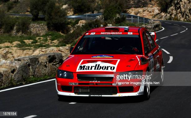 Francois Delecour and Daniel Grataloup driving the Mitsubishi Lancer Evo during the Spanish World Rally Championship in the Catalunyan region Spain...