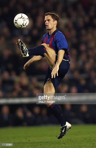 Frank de Boer of Barcelona brings the ball under control during the UEFA Champions League Second Stage Group B match between Barcelona and Liverpool...