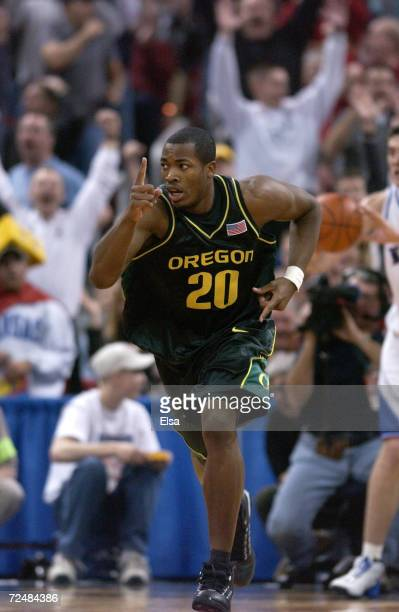 Frederick Jones of Oregon celebrates his three point basket during the NCAA Mens Basketball Tournament at the Kohl Center in Madison Wisconsin The...