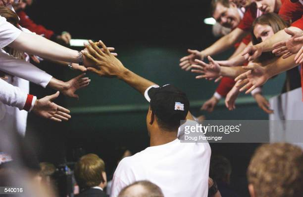 George Lynch of Indiana celebrates with fans after winning in the South Region of the NCAA Men's Basketball Championship against Kent State at the...