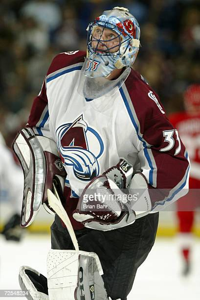 Goalie Patrick Roy of the Colorado Avalanche looks up at the clock as time gets low against the Detroit Red Wings at the Pepsi Center in Denver,...