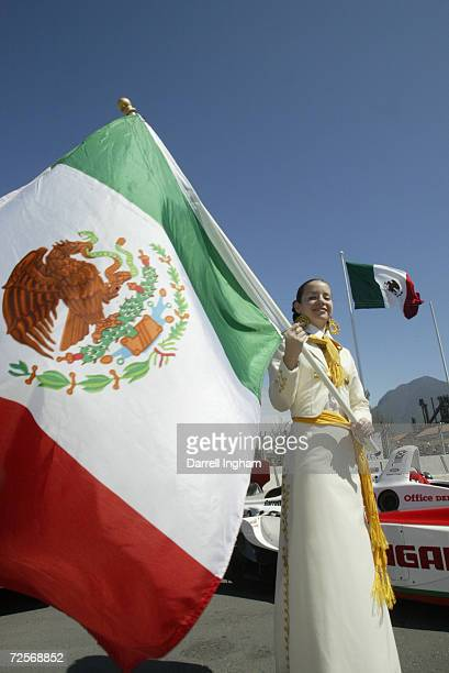 Grid girl holding the Mexican flag at the Tecate Telmex Grand Prix of Monterrey, round 1 of the CART FedEx Championship Series at Fundidora Park in...