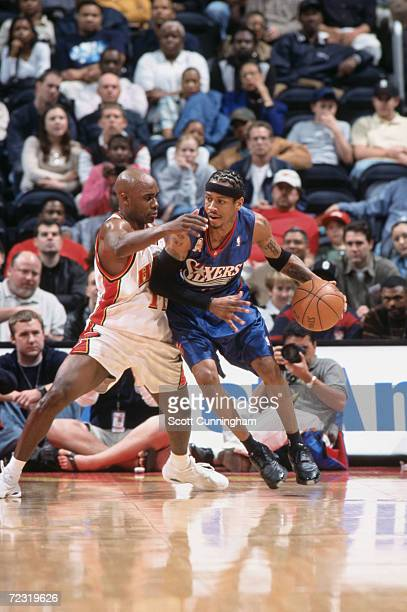 Guard Allen Iverson of the Philadelphia 76ers posts up point guard Jacque Vaughn of the Atlanta Hawks during the NBA game at the Philips Arena in...