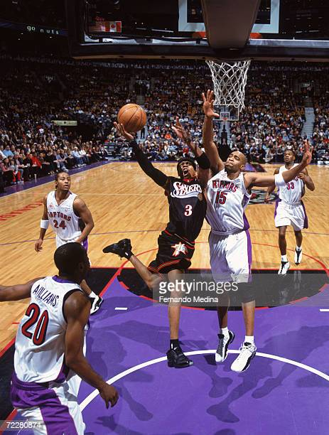 Guard Allen Iverson of the Philadelphia 76ers shoots the ball as guard Vince Carter of the Toronto Raptors attempts to block during the NBA game at...