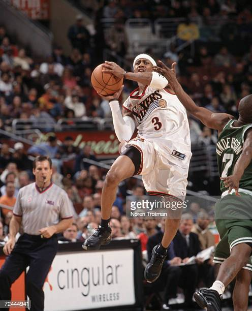 Guard Allen Iverson of the Philadelphia 76ers shoots the ball as point guard Kenny Anderson of the Boston Celtics attempts to block during the NBA...