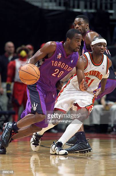 Guard Alvin Williams of the Toronto Raptors dribbles the ball around guard Jason Terry of the Atlanta Hawks during the NBA game at Philips Arena in...
