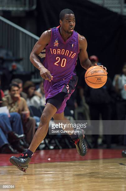 Guard Alvin Williams of the Toronto Raptors dribbles the ball during the NBA game against the Atlanta Hawks at Philips Arena in Atlanta Georgia The...